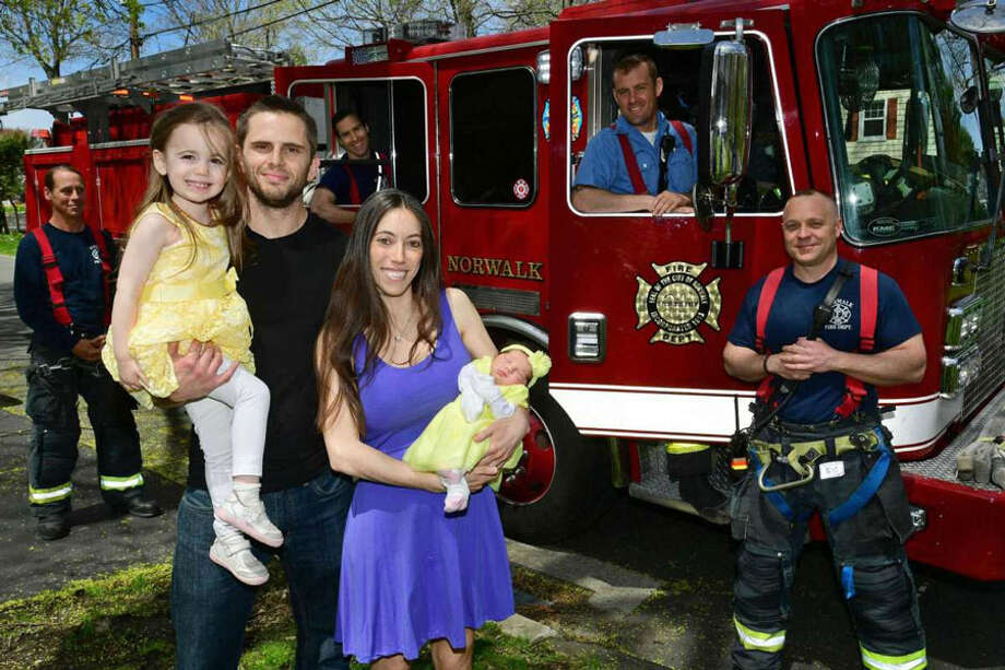 Norwalk firefighter David Dustin and his wife Christina and their daughter Grace, 3, and newborn, Allie, at their home Thursday, April 25, 2019, in Norwalk, Conn. Last Friday Norwalk firefighters and paramedics assisted in the birth of the Dustin's new daughter after Christina had to give birth in the ambulance on the way to the hospital. — Erik Trautmann/Hearst Connecticut Media