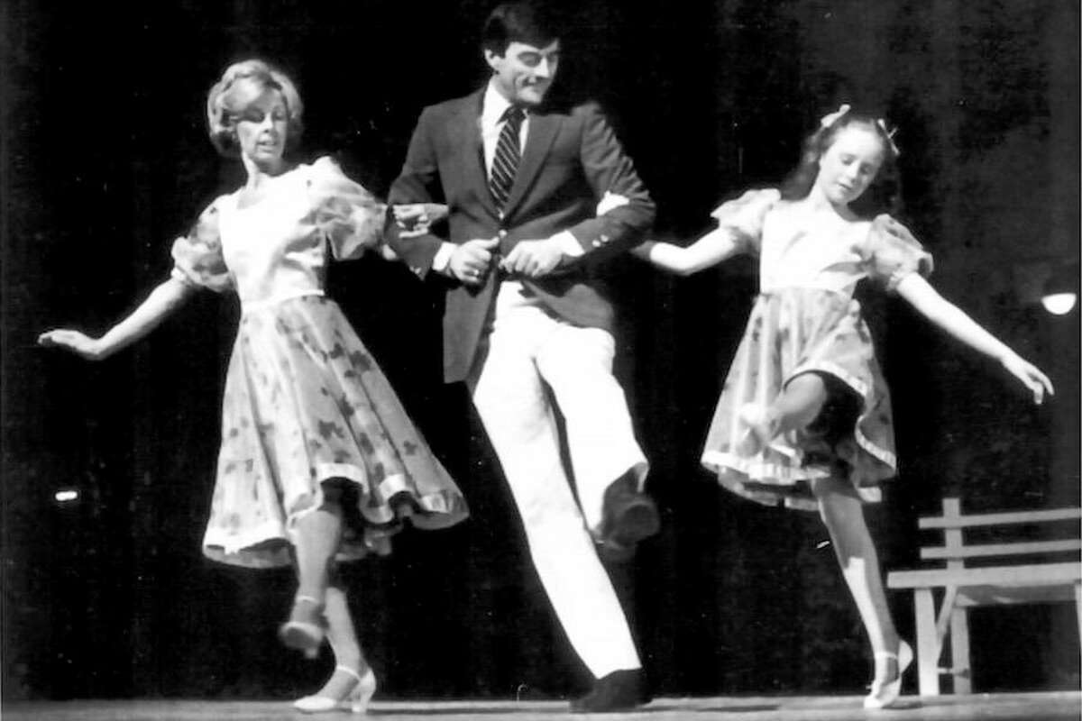 Walter Schalk dances with Susie Eynon, left, and Shauna McCarthy at his 25th anniversary show in 1982