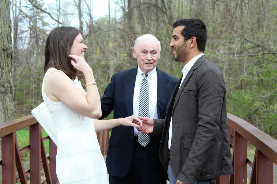 Meghan Pollak was all smiles at her marriage to Mehdi Sabri in Merwin Meadows Park in Wilton on April 22, 2019. Officiating was Justice of the Peace Charles Flynn.