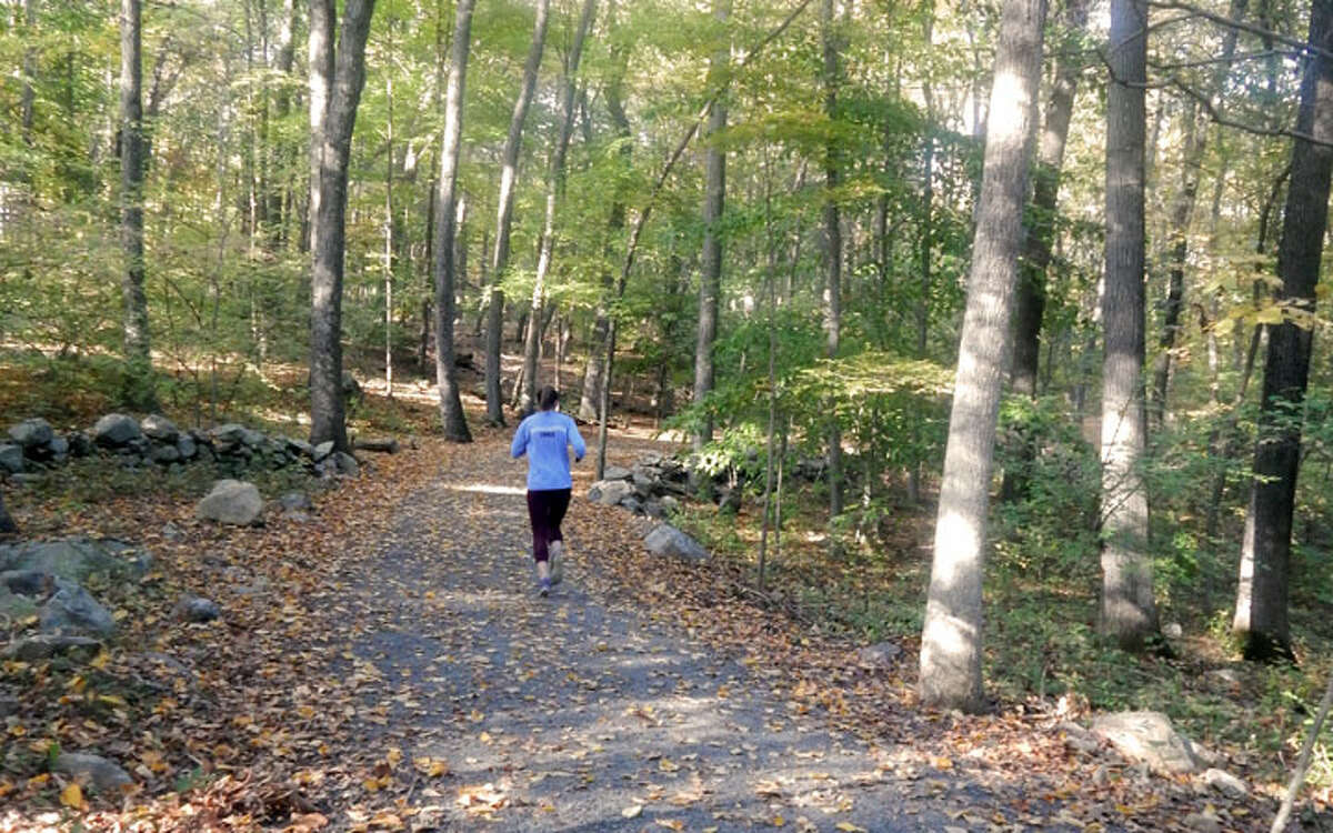 A jogger runs along the Wilton loop of the Norwalk River Valley Trail. Redding is working on having a similar portion of the trail. - Kendra Baker photo