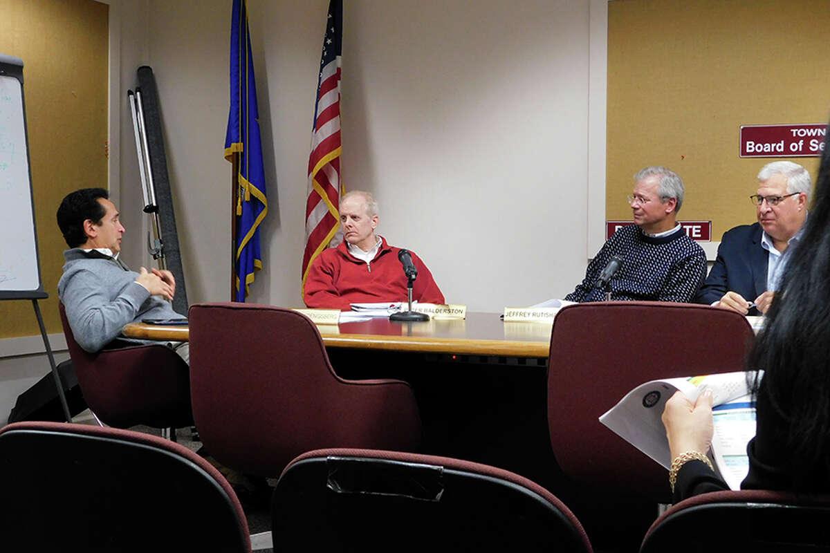 Board of Finance members, from left, Stewart Koenigsberg, Peter Balderston, Jeff Rutishauser, and Walter Kress at a 2018 board meeting. - Kendra Baker photo