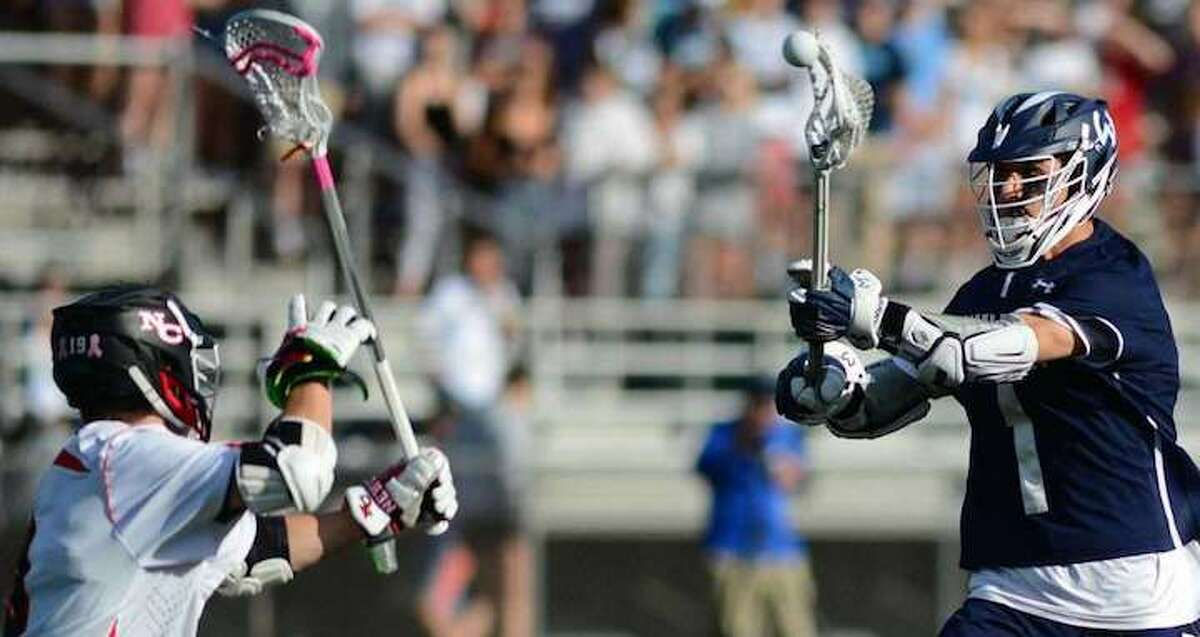 Wilton's Dean DiNanno fires a shot during the FCIAC boys lacrosse championship game. - Erik Trautmann / Hearst Connecticut Media