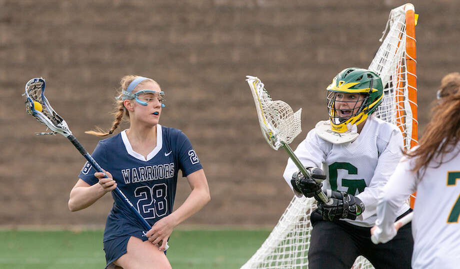 Anna Sherman looks to get around the Greenwich Academy goalie during Thursday's season-opening game. — GretchenMcMahonPhotography.com