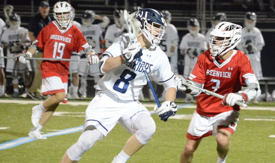 Andrew Luciano looks to get past a Greenwich player in Saturday night's game. — Andy Hutchison photo