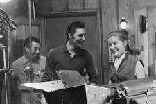 "Elvis Presley, at a recording session with actress Dolores Hart for the 1957 movie ""Loving You."" Below, the actress has lived as a nun in Bethlehem, Conn., for 56 years. Posters from her short film career remain."