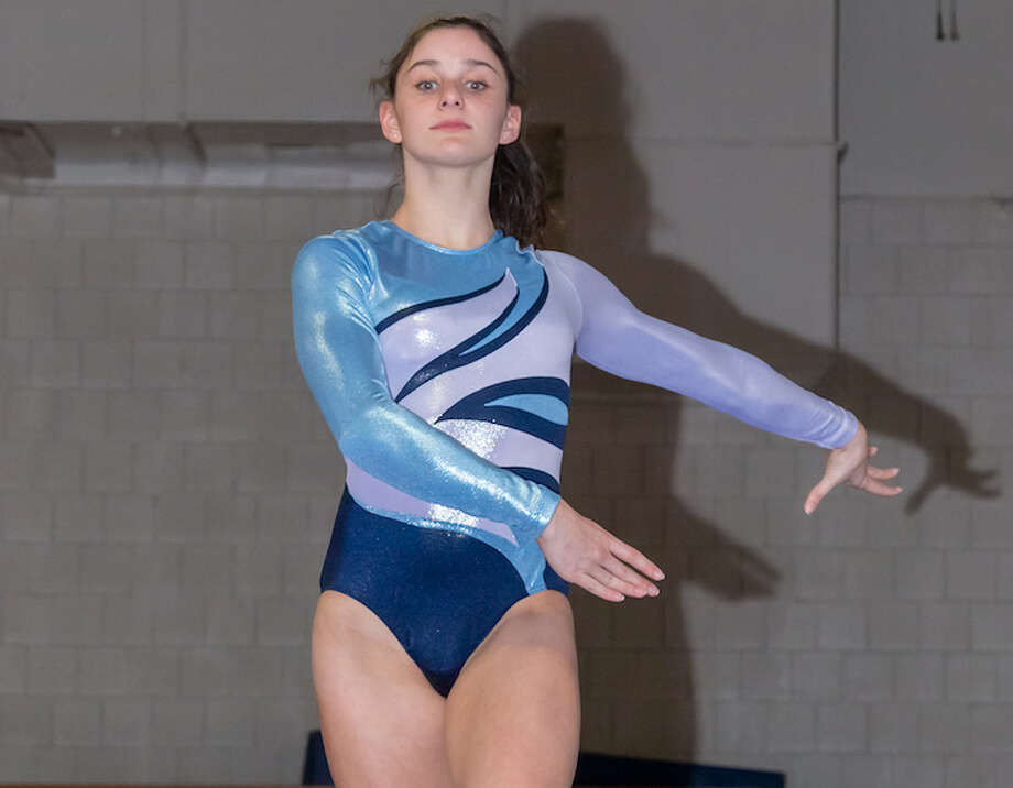 Wilton High senior Jessica Olin won two events at the State Open gymnastics championship meet. — GretchenMcMahonPhotography.com