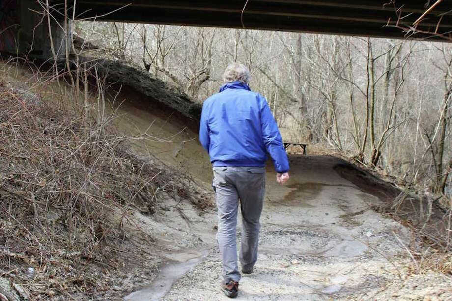"Charlie Taney, executive director of the Norwalk River Valley Trail, walks along part of the Norwalk portion's ""missing link."" — Kelly Kultys photo"