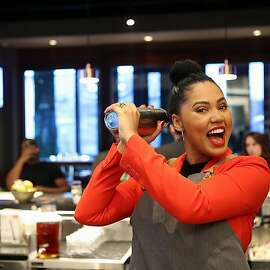 Ayesha Curry visited International Smoke, the restaurant she owns with partner chef Michael Mina, in Houston Wednesday. The cookbook author and lifestyle expert is in Houston for several days with events at the restaurant and to benefit Kids' Meals to end childhood hunger.