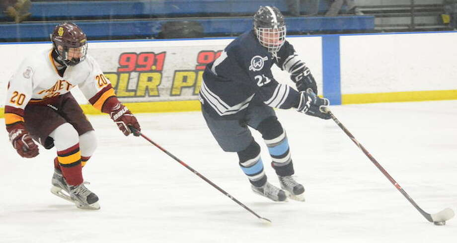 Nico Kouvaris (right) and the Wilton boys hockey team have qualified for the Division III state tournament. — Andy Hutchison photo