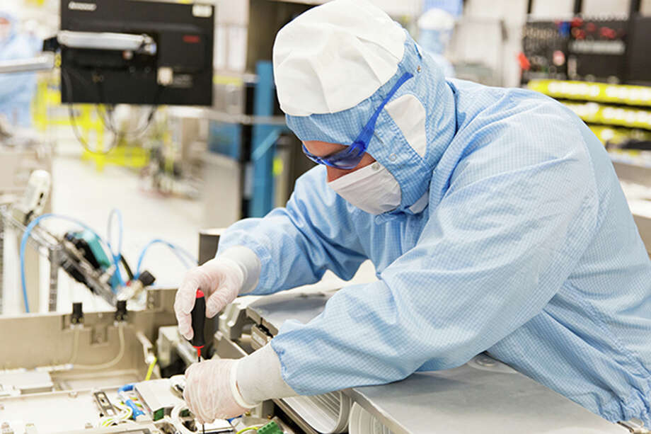 """A worker in one of ASML's """"clean rooms."""""""