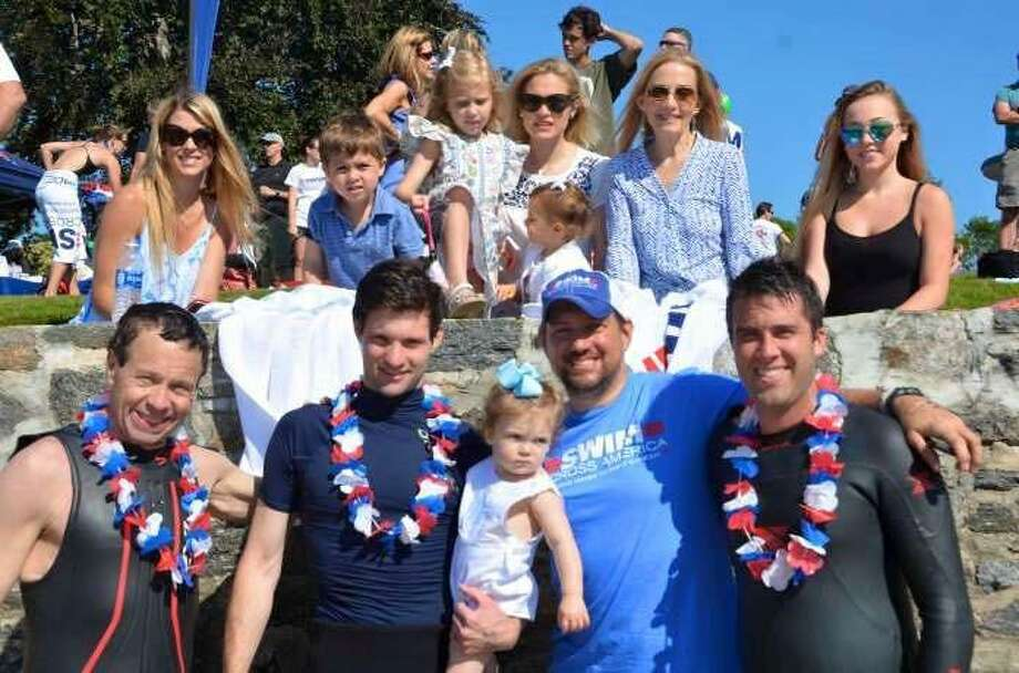 Wendy Lawrence-Probert, second from upper right, and her family and friends supporting her brother Craig Lawrence at the annual Swim Across America Fairfield County open water swim. Photo: Contributed Photo