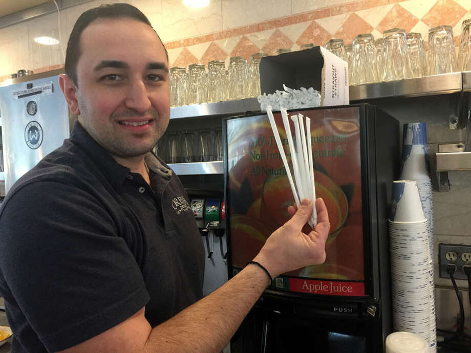 Demetri Papanikolaou, co-owner of Orem's Diner, may be ordering less straws for his business. — Patricia Gay/Hearst Connecticut Media