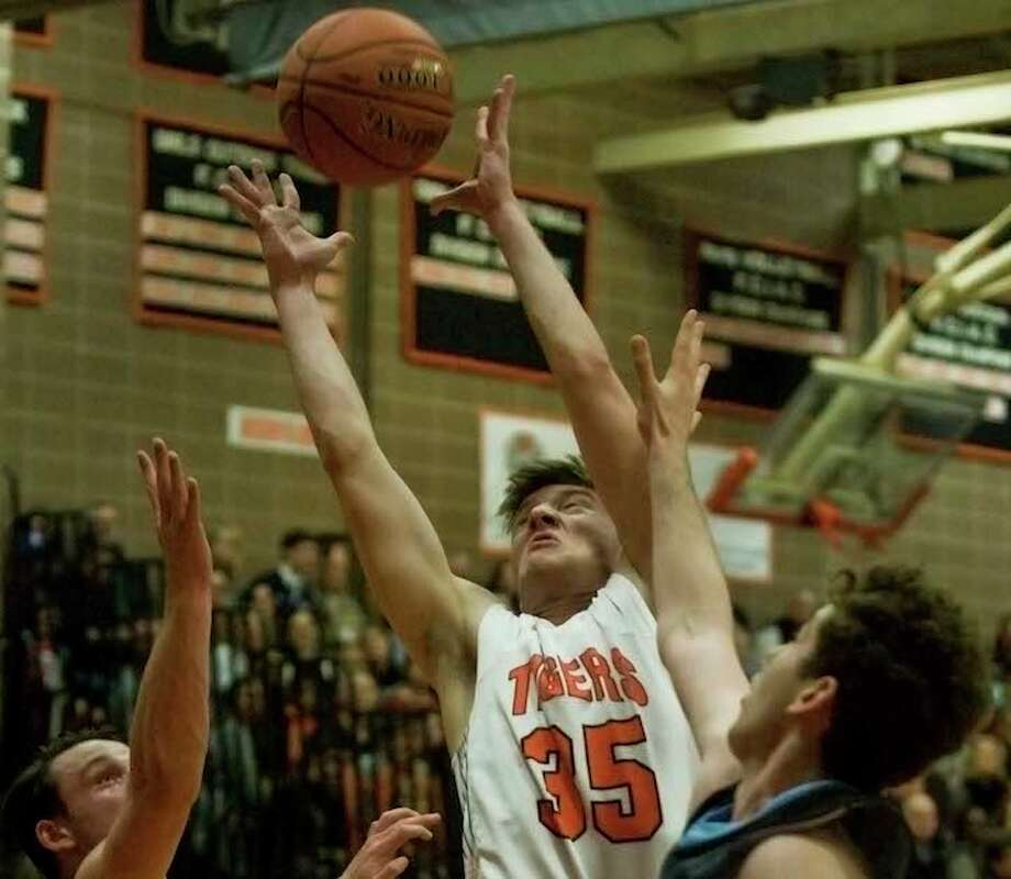 Ridgefield's Matt DeLuca grabs a rebound during Friday afternoon's game against Wilton. — Scott Mullin/Hearst Connecticut Media / Scott Mullin ownership
