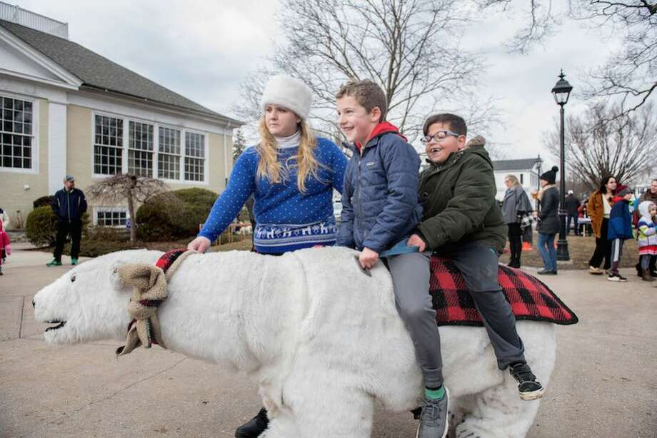 Nick Sposato, 7, and Ryan Ciannello, 7, of Wilton ride a polar bear from Safari Rides and Photos of Wallingford on Sunday, January, 27, 2019 at the Wilton Winter Carnival. — Bryan Haeffele photo