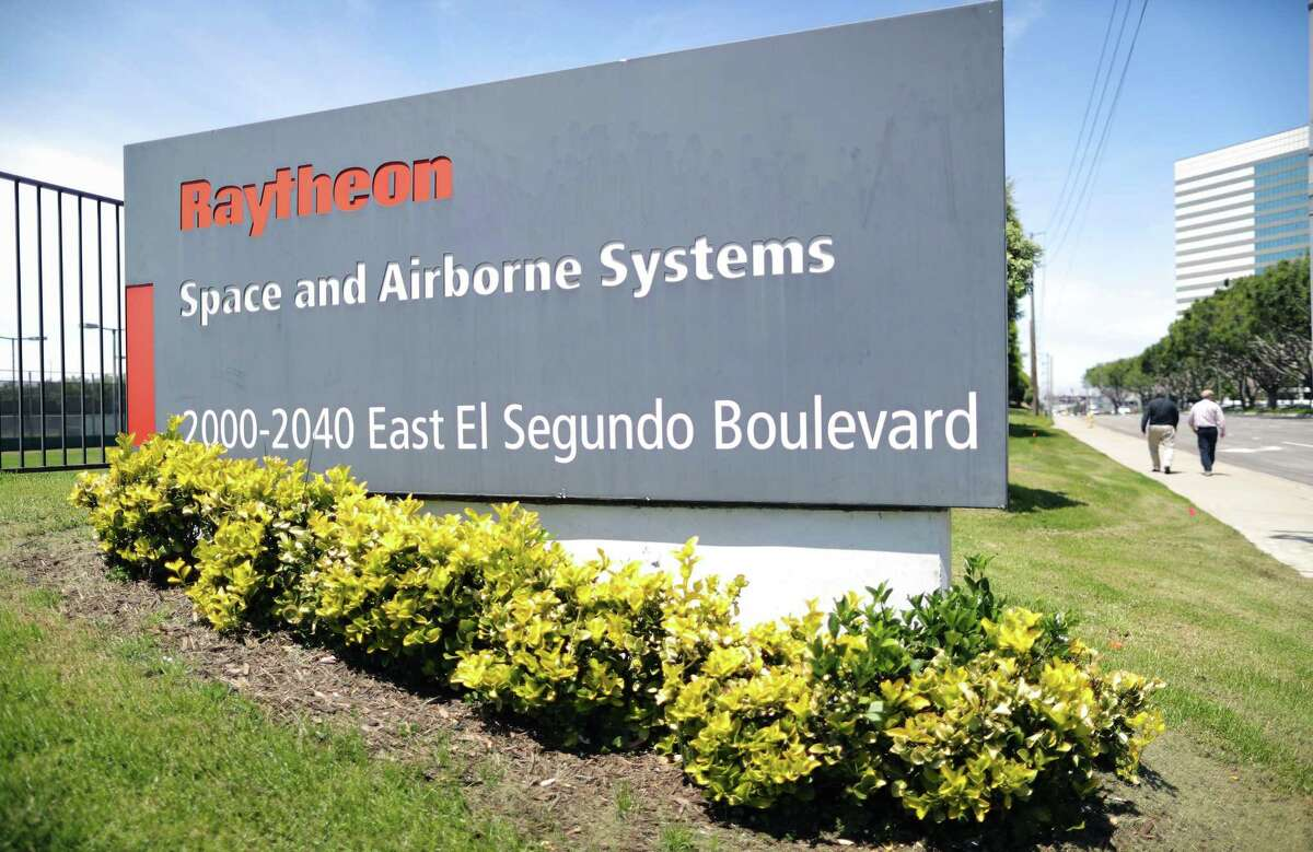 A company sign is posted at a Raytheon Co. campus on June 10, 2019 in El Segundo, California. Raytheon Co. and United Technologies Corp. have announced a merger creating a defense and aerospace powerhouse in one of the largest corporate mergers of 2019.