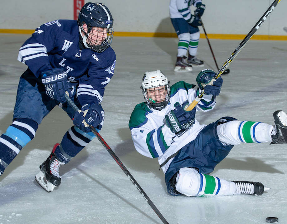 David Overbeeke skates around a fallen Norwalk/McMahon player during Wilton's 4-2 win last week. — GretchenMcMahonPhotography.com