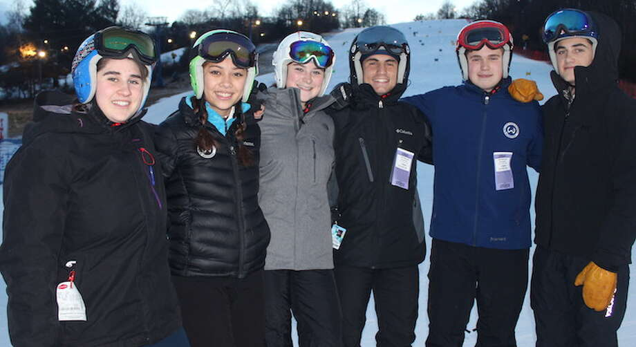 Hope Ulmann, Emily Welch, Emily O'Brien, Dom Polito, Scott Verrilli, and August Theoharides (left to right) are the captains for this year's Wilton High ski teams.