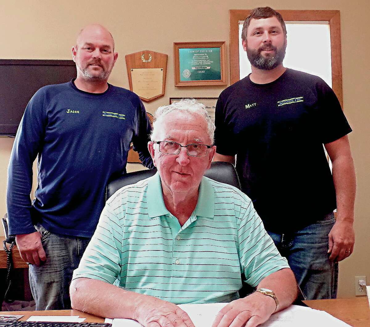Tom Herron, center, sold his company, Herron Building, to (from left) brothers Jason and Matt Klein, who also own Superior 1 Plumbing and Heating in Cass City.