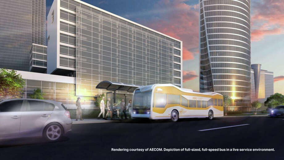 This rendering, courtesy of AECOM, depicts a fill-sized, full-speed bus in a live service environment. Officials from the Michigan Department of Transportation recently contacted Huron Transit Corp, also known as Thumb Area Transit, and inquired about potentially bringing automated buses to the Thumb. Photo: Photo Courtesy Of AECOM