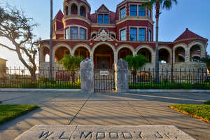 The Moody Mansion, adorned with turrets, dormers and arches, was designed by architect W.H. Tyndall.
