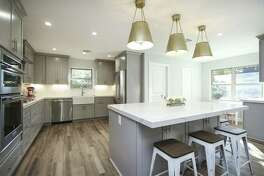 This remodel boasts easy-to-maintain quartz countertops and wood-look tile.