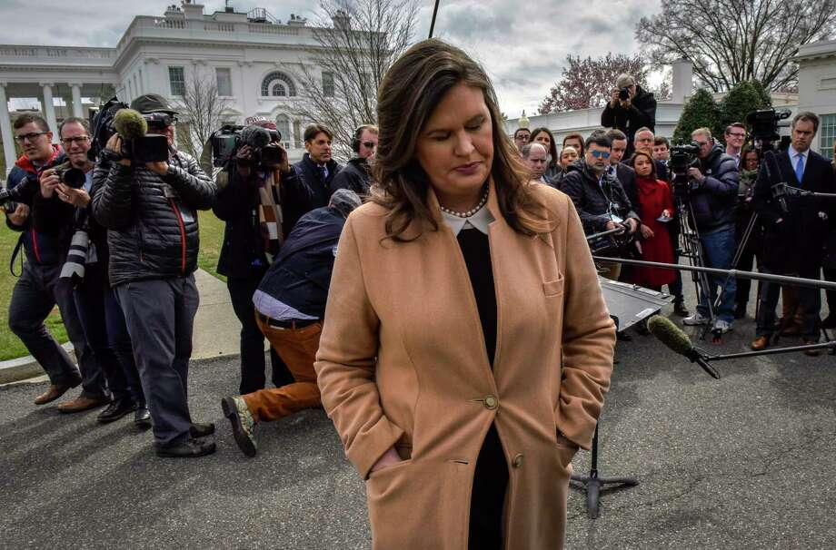 Sarah Sanders turns away after talking to reporters outside the White House in April. Photo: Washington Post Photo By Bill O'Leary / The Washington Post