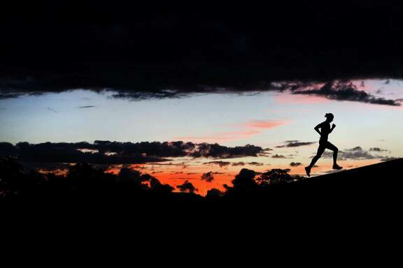 Andrew Keat, a member of the Rice University track team, runs at Hermann Park Wednesday, Oct. 19, 2016, in Houston. ( Jon Shapley / Houston Chronicle )
