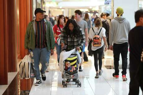 Large crowds were in search of deals at The Galleria Friday, Nov. 23, 2018, in Houston.
