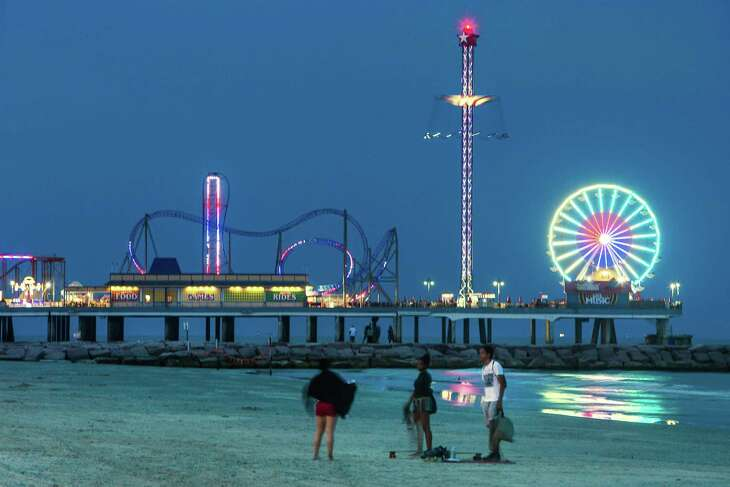The lights of the Pleasure Pier light up the night sky.