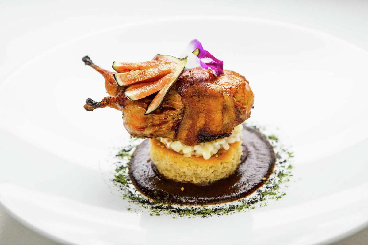 Negro en Negro (Tejas Heritage Farm black-footed chicken, mole negro and creamy corn meloso) at Xochi photographed July 10, 2018, in Houston, Texas. Photo byNickdelaTorre ****FOR TOP 100 DO NOT USE WITHOUT EDITOR'S PERMISSION ***