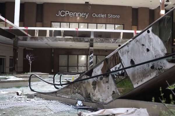 """Producer and filmmaker Dan Bell has visited more than 70 dead malls across America, uploading video tours to his YouTube channel. He says he's seen some crazy things over the years, from malls on the verge of demolition to others with roofs so leaky, rainstorms came inside. """"These malls are just ending up completely empty and just shells of their former selves,"""" he told Business Insider."""