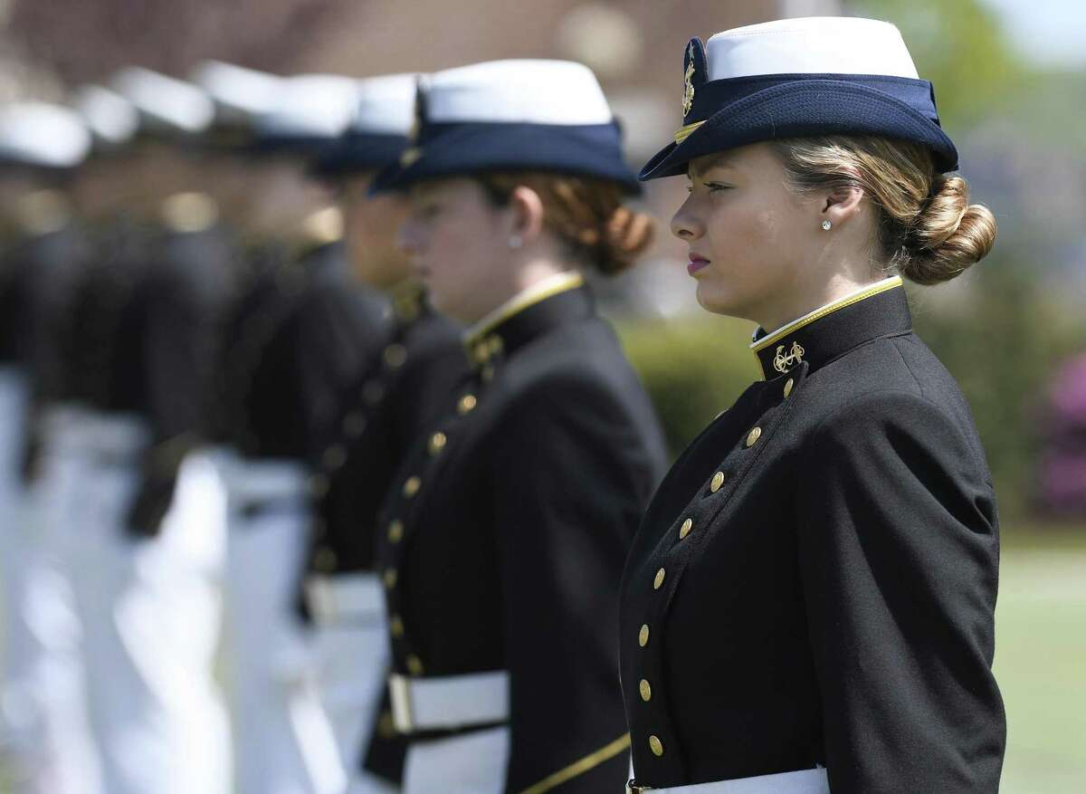 Female cadets at the United States Coast Guard Academy line up during commencement in New London last month.