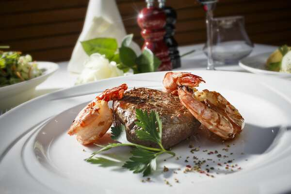 Steakhouse situation - Surf and Turf Dinner - Steak served with King prawns