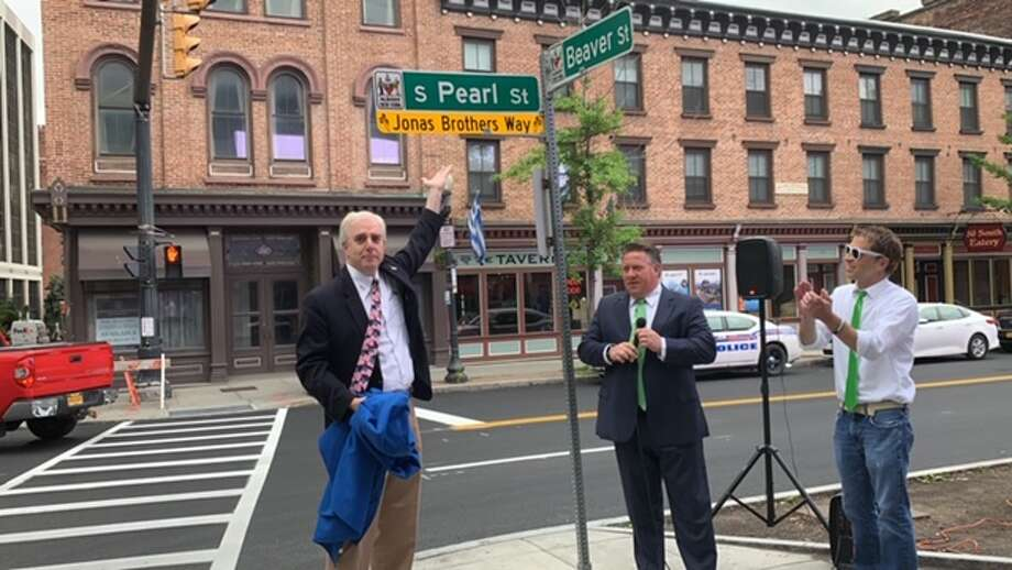 Albany County Executive Daniel McCoy and Albany city Treasurer unveil street sign renamed in tribute to the Jonas Brothers, which is coming to the Times Union Center in August. South Pearl Street has been temporarily renamed Jonas Brothers Way at the corner of Pearl and Beaver streets on June 14, 2019. (Amanda Fries / Times Union) Photo: Amanda Fries / Times Union