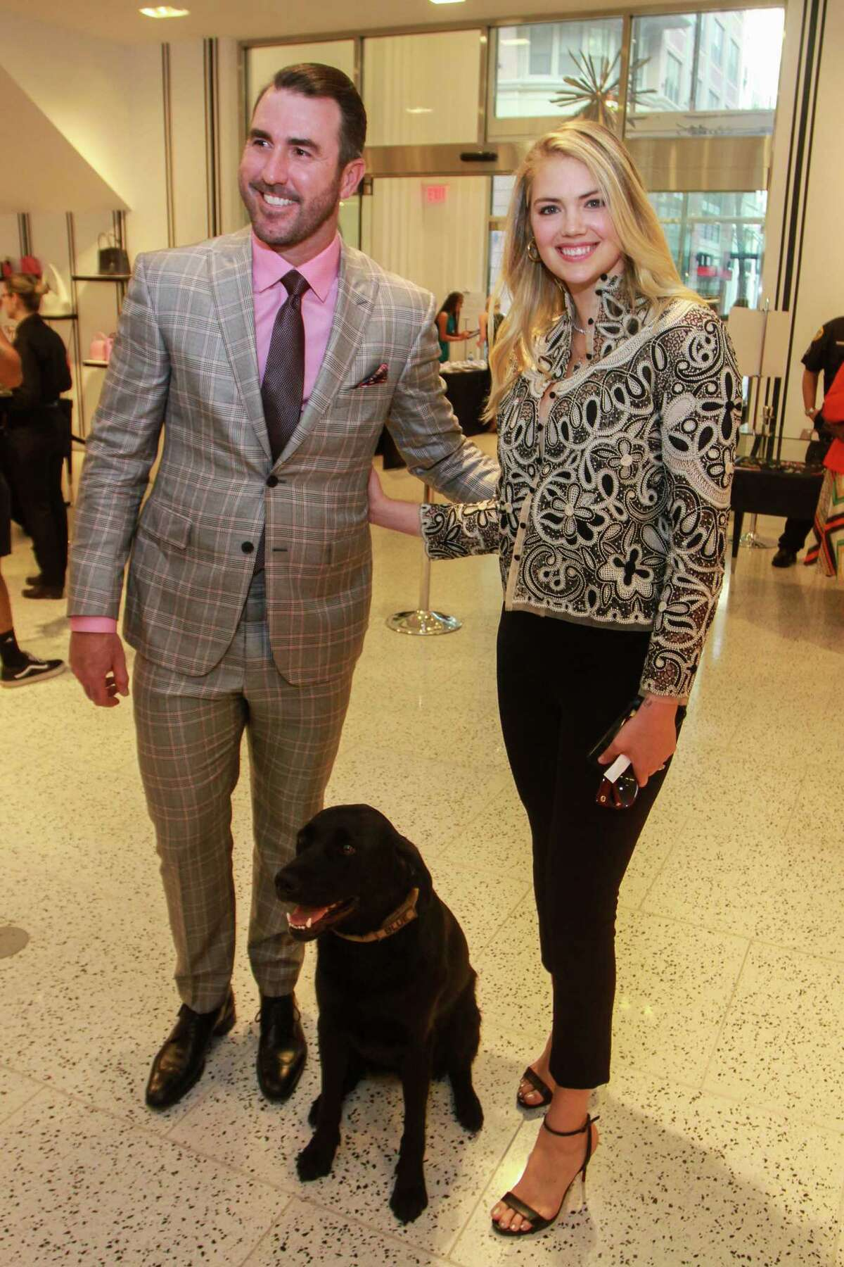 Justin Verlander and Kate Upton with Blue, a rescue dog trained in explosive detection, at Astros Team Up for Kids and K9s at Tootsies.