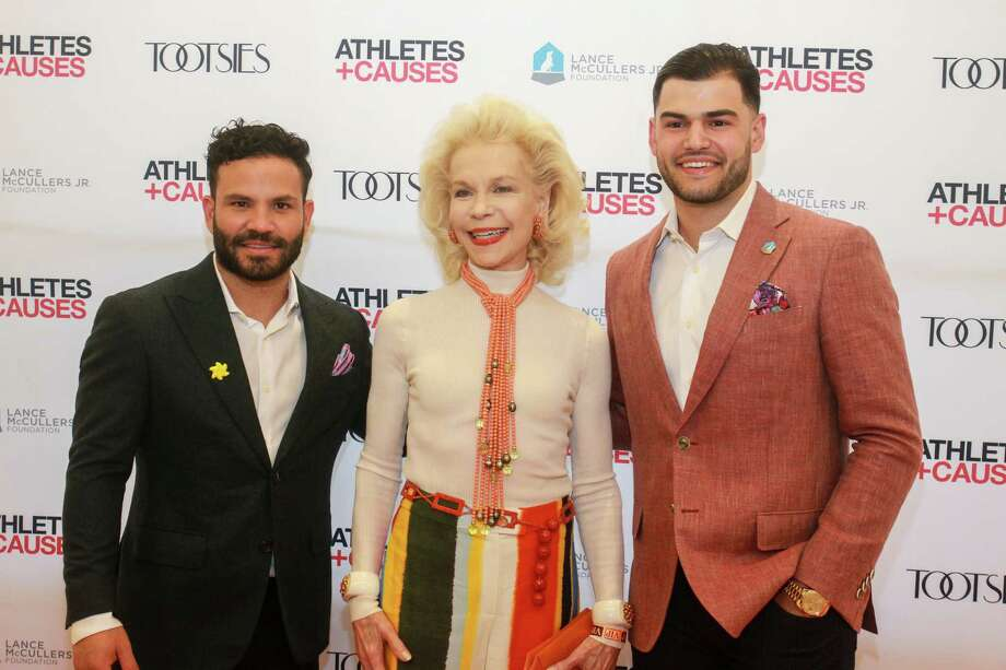 Jose Altuve, from left, Lynn Wyatt and Lance McCullers at Astros Team Up for Kids and K9s at Tootsies. Photo: Gary Fountain, Contributor / © 2019 Gary Fountain