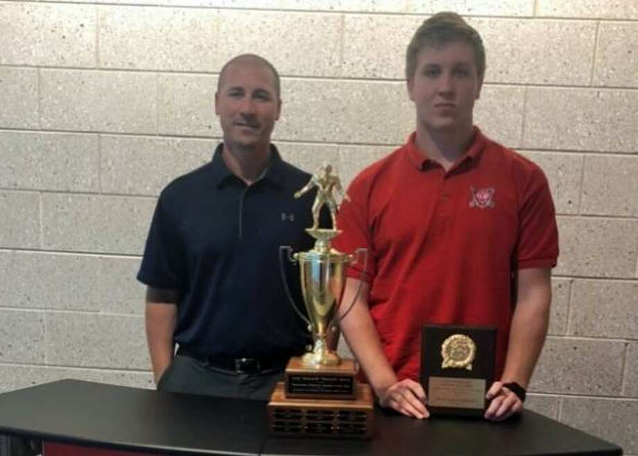 Stamford High Athletic Director Christopher Passamano poses with David Marciczkiewicz, who recieved the Robustelli Award for top lineman in Stamford. Photo: Contributed Photo /