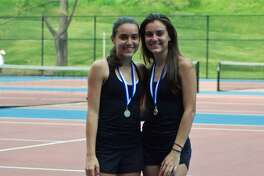 Stamford High School juniors Taylor and Devon Yaghmaie pose after winning their State Championship Title.