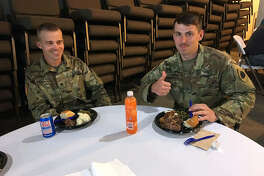 The troops welcomed the food after a day of work.
