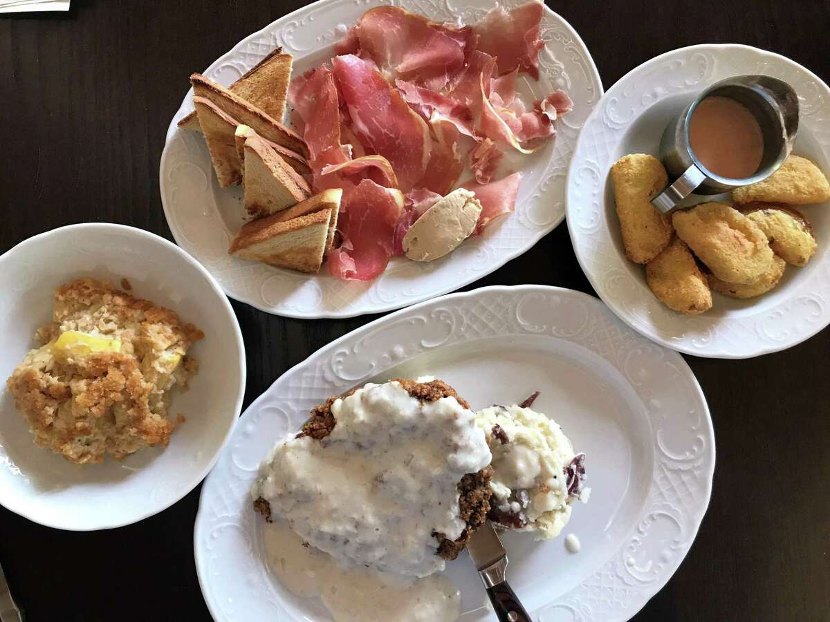 Clockwise from Squash casserole, country ham plate, fried green tomatoes and chicken fried steak from Fontaine's Southern Diner & Bar
