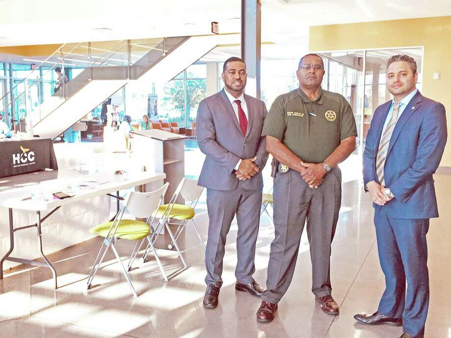 Fort Bend County District Attorney Brian Middleton was among a group of Fort Bend County VIPs who came to speak to students at an open house gathering at the Houston Community College Missouri City Campus on Wednesday, June 12. Pictured from left: Brian Middleton, First Assistant District Attorney Ibrahim E. Khawaja, Edward Gordon Jr., Chief Investigator. Photo by Kristi Nix