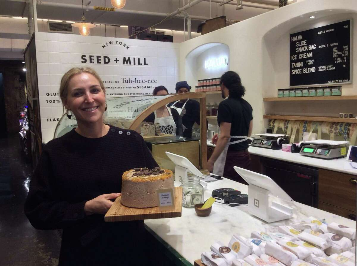 Rachel Simons, the co- owner of Seed & Mill at the Chelsea Market in NYC shows off the chocolate and orange halva, made with tahini.