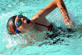 Kennedy Williams from Montclaire swims in the 9-10 girls 100-meter freestyle during Thursday's dual meet against Summers Port at Montclaire.