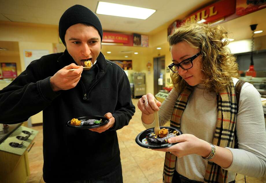 "Siblings Andrew and Amanda Ciarlelli, of Watertown, eat at the Barone Campus Center Dining Hall at Fairfield University. Sen. Will Haskell, D-Westport, said there's been a growing problem of college-aged people not having access to a ""sufficient quantity of affordable, nutritious food."" Photo: Brian A. Pounds / Hearst Connecticut Media / Connecticut Post"