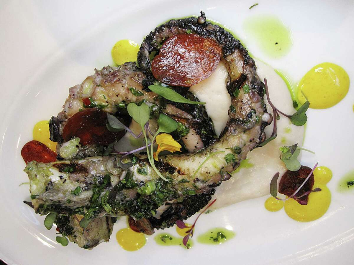 Grilled Spanish octopus is plated with chorizo, cannellini bean puree, chimichurri and saffron lemon sauce at Mako's on the Creek in Cibolo.