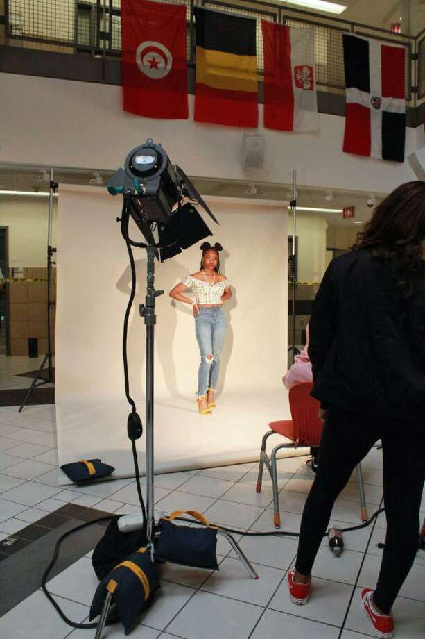 AITE students set up and get ready to take a photograph of a student model. Photo: Laysha Lucero / Contributed Photo