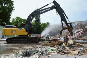 A construction crew begins demolition of the former Pet Pantry building in Greenwich, Conn. Wednesday, June 12, 2019. The Town of Greenwich will begin construction on a new substation and line project at the site that will improve electric reliability wihtin the town.