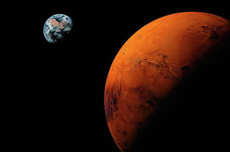 Computer illustration comparing the size of Mars (left) with that of the Earth. Mars diameter is 53 percent that of the Earths. It has 10 percent the mass of Earth and is, on average, 1.53 times further from the Sun. While the Earth is host to oceans of liquid water and has a relatively dense water-rich atmosphere, Mars is exceedingly dry, cold and, as far as we know, sterile. It is thought to have lost most of its water to space a long time ago, and any that remains is frozen at the poles and locked deep in the ground as permafrost.