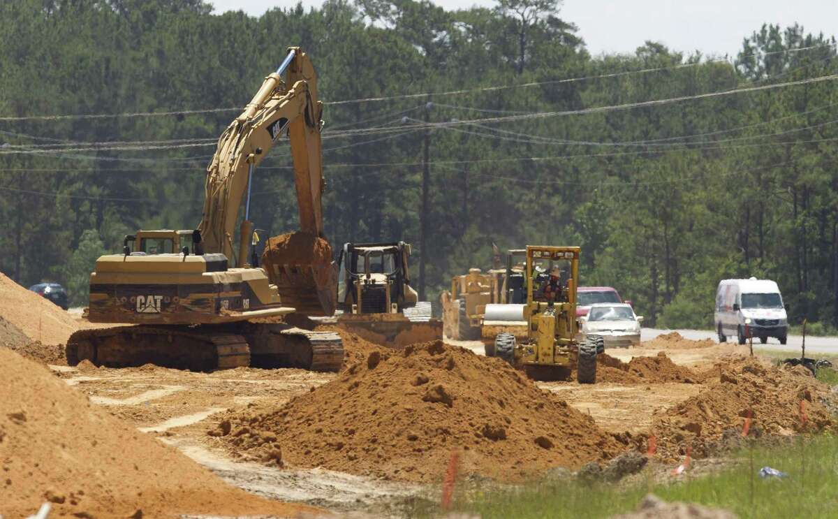 Construction crews work to widen Texas 242 between FM 1314 and I-45 as part of a partnership between Montgomery County and Texas Department of Transportation, Thursday, June 13, 2019.