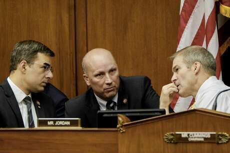 From left: Rep. Justin Amash (R-Mich.), Chip Roy (R-Texas), and Ranking Member Jim Jordan (R-Ohio) confer during a hearing of the House Oversight and Reform Committee considering a vote to recommend that the House hold Attorney General William Barr and Commerce Secretary Wilbur Ross in contempt, on Capitol Hill in Washington, June 12, 2019. President Donald Trump claimed executive privilege to block Congress' access to documents about how a citizenship question was added to the 2020 census ahead of the committee's vote. (T.J. Kirkpatrick/The New York Times)